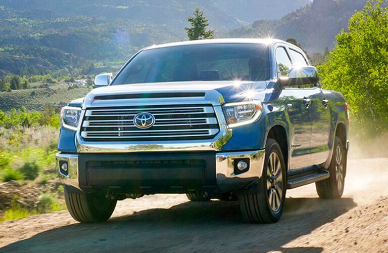 Front grille of 2020 Toyota Tundra driving on dirt road