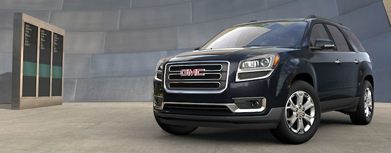GMC Acadia parked near a building