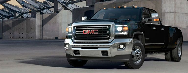 GMC Sierra 3500HD parked in front of a concrete structure