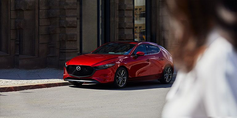 A 2019 Mazda3 hatchback on a city street