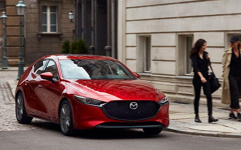 2019 Mazda3 on the street next to pedestrians