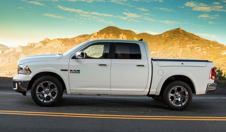 white 2018 Ram driving down the highway