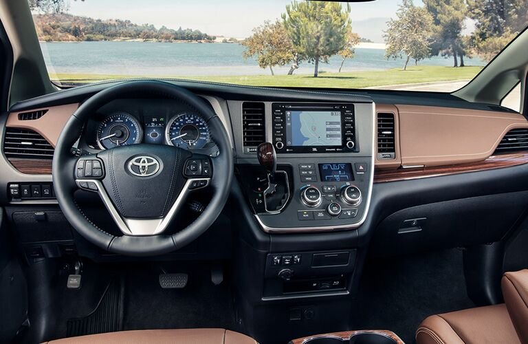 Steering wheel and touchscreen of 2018 Toyota Sienna with flowing dashboard lines