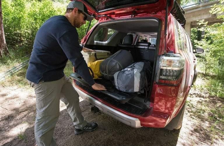 Man using sliding cargo deck of 2018 Toyota 4Runner