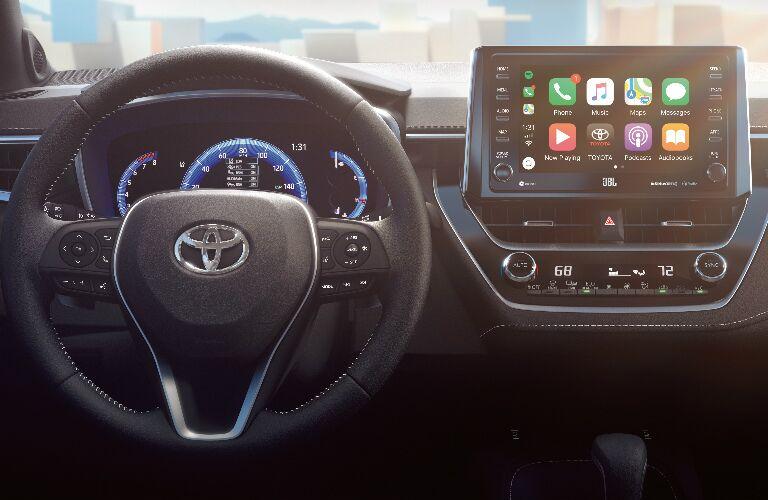 Steering Wheel, Gauges, and Touchscreen of 2019 Toyota Corolla Hatchback