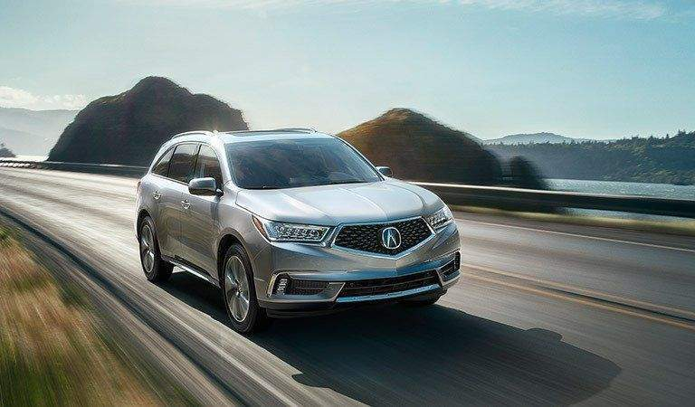 Acura MDX driving on a mountain road