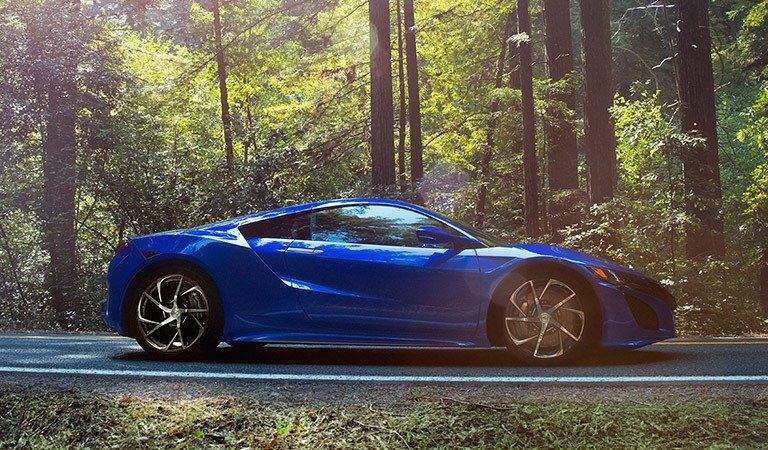 Acura NSX parked in a forest