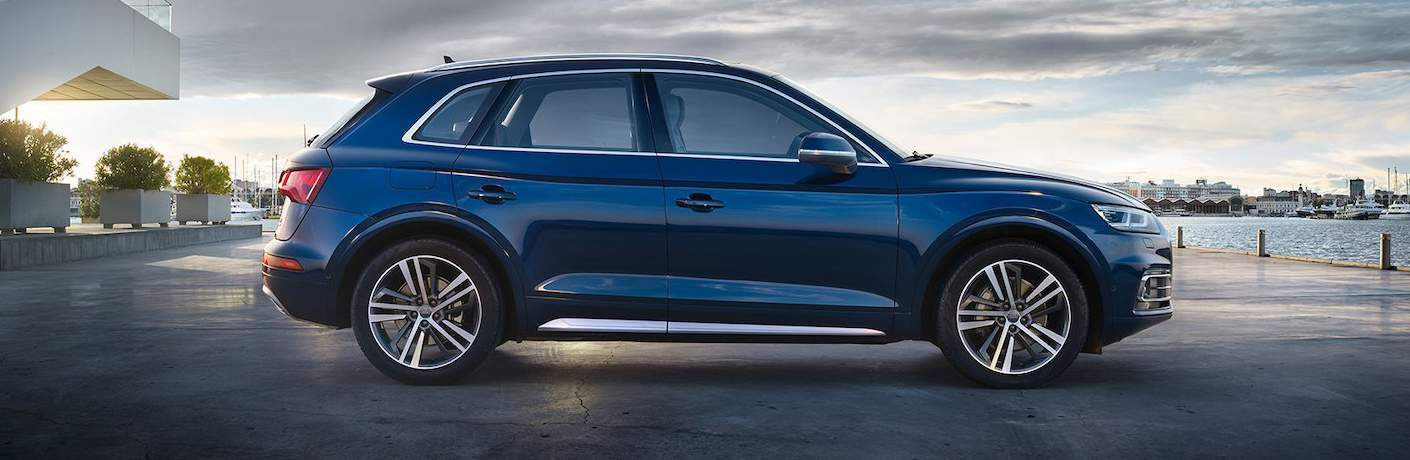 Side shot of blue 2018 Audi Q5 in front of waterfront