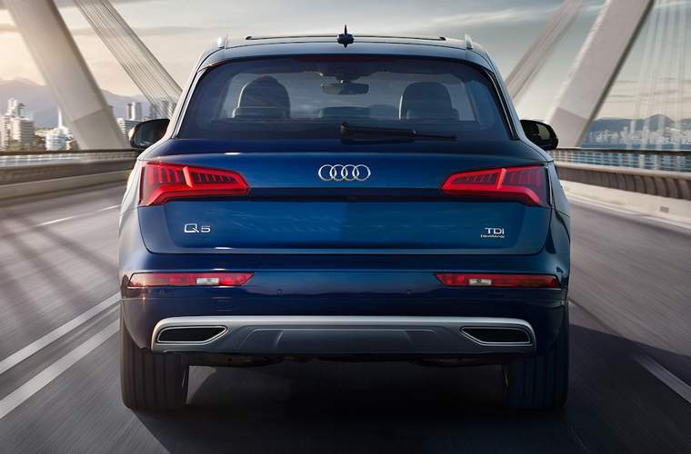 Rear view of 2018 Audi Q5 driving on bridge