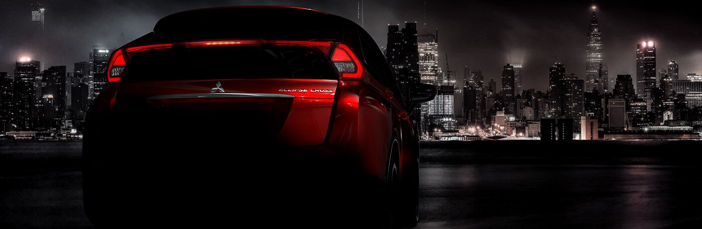 exterior rear of the 2018 Mitsubishi Eclipse Cross overlooking a night city skyline