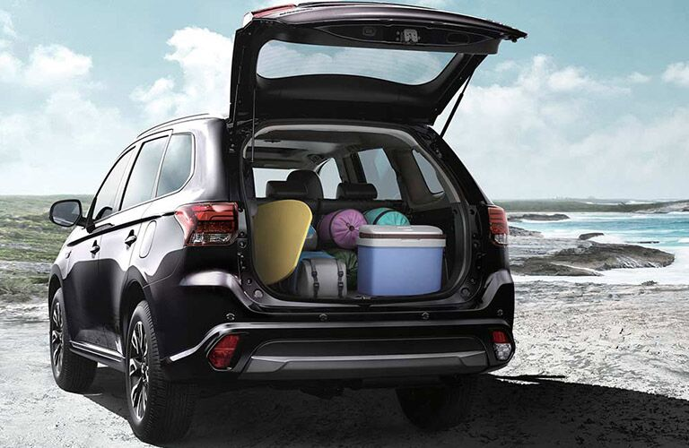 exterior view of the 2018 Mitsubishi Outlander PHEV with the trunk open