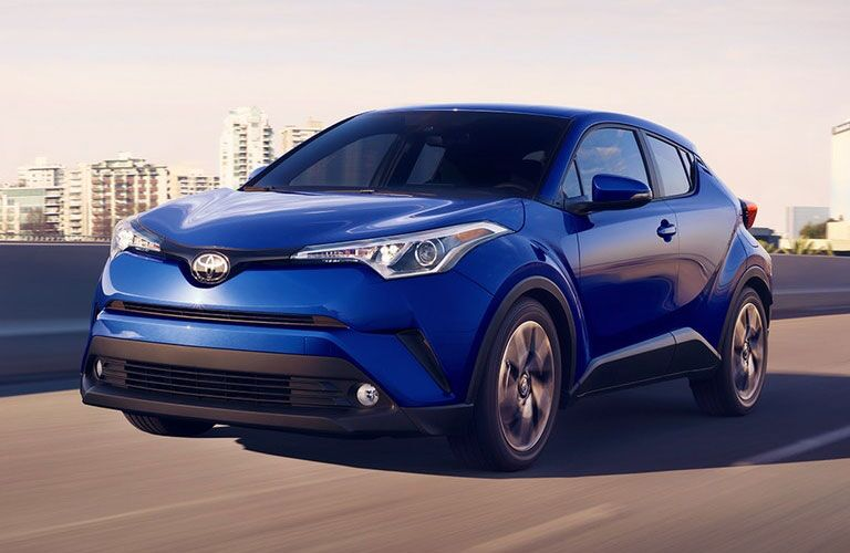 Toyota C-HR driving on a city road