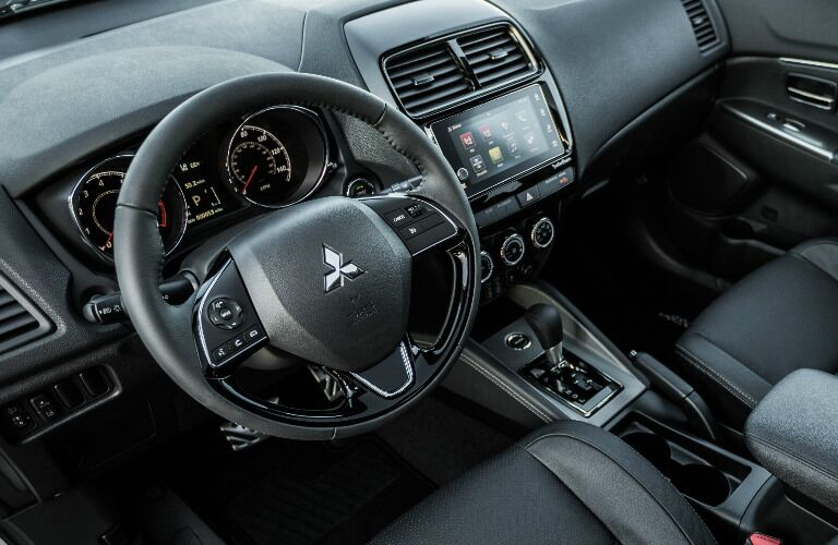 2018 Mitsubishi Outlander Sport interior steering wheel and dashboard