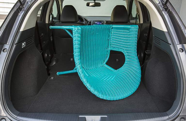 cargo space in the 2018 Honda HR-V used by a blue wicker chair