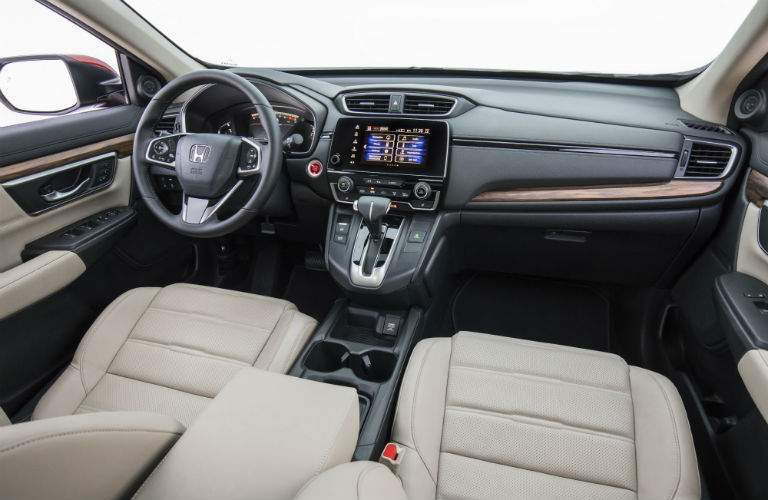 view of the front interior of the 2018 Honda CR-V showing the steering wheel and controls