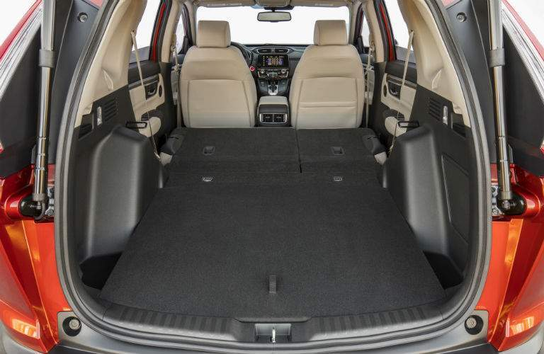 view from the opened hatch back of the 2018 Honda CR-V with the seats folded down for maximum cargo space