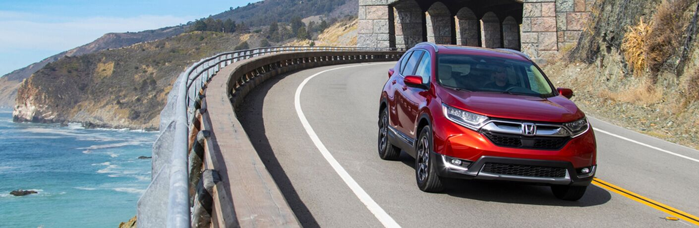 2019 Honda CR-V driving on an oceanside road