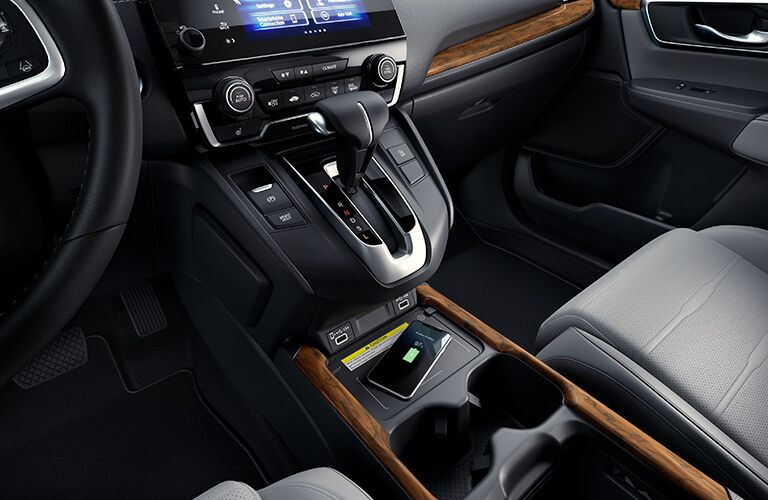 Smartphone charges happily on the wireless charging pad inside a 2020 Honda CR-V.