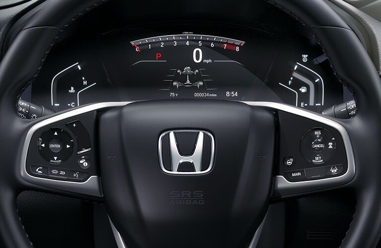 Steering wheel and digital gauges inside a 2020 Honda CR-V.