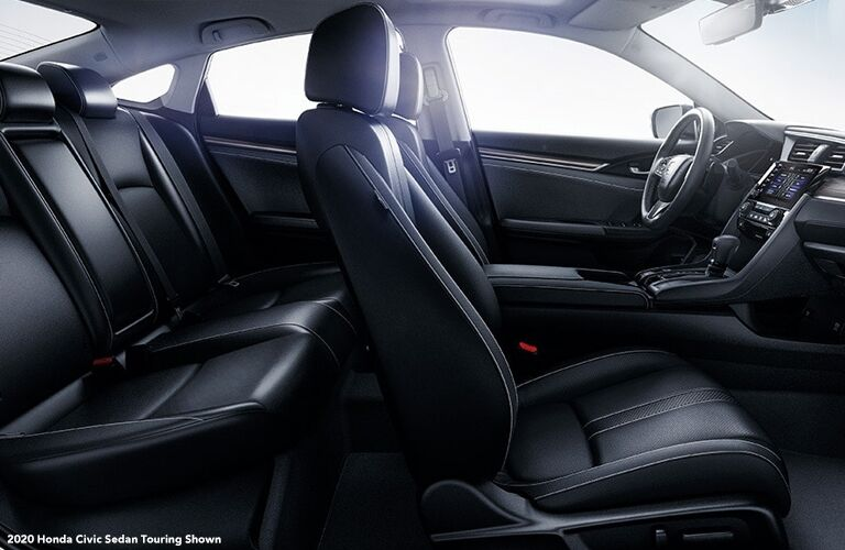 Cutaway side view of both rows of seats inside a 2020 Honda Civic Sedan.