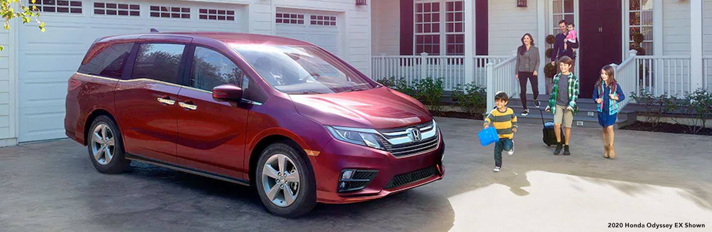 A family leaves their house and rushes to the red 2020 Honda Odyssey in their driveway.