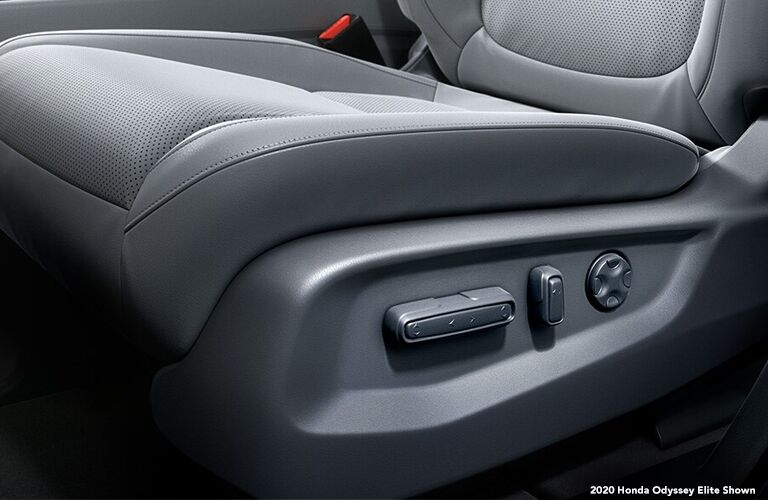 Close-up view of the seat controls on a seat inside a 2020 Honda Odyssey.
