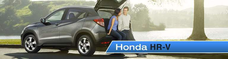"image of a couple sitting in the opened hatch back of the Honda HR-V, labeled ""Honda HR-V"""