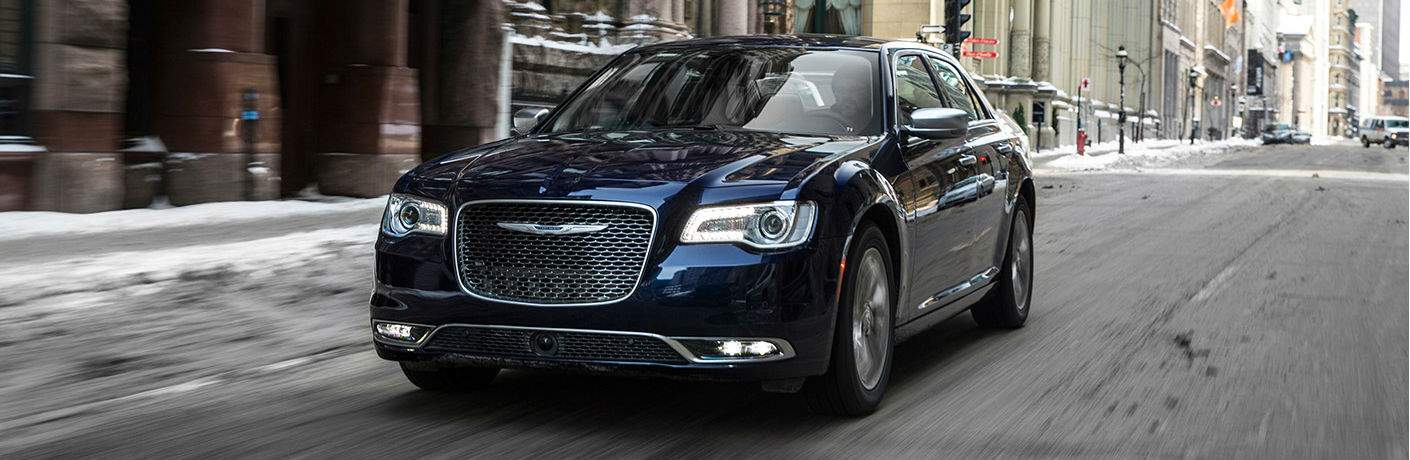 2017 Chrysler 300 driving down a street