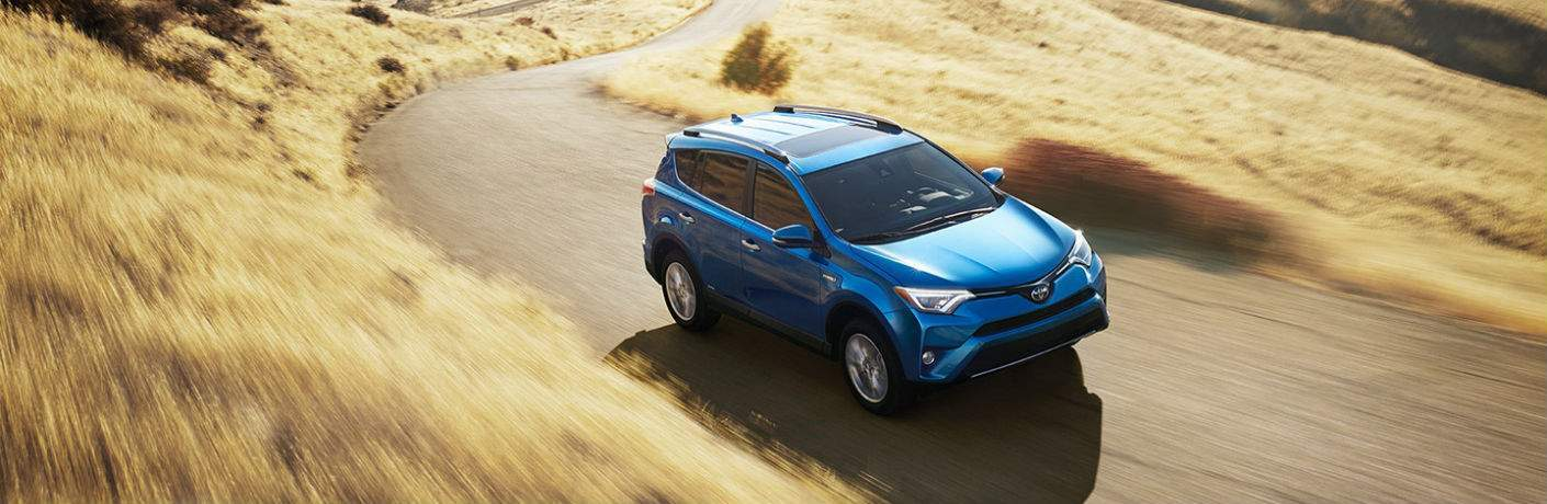 An overhead photo of 2018 Toyota RAV4 driving down over a country road