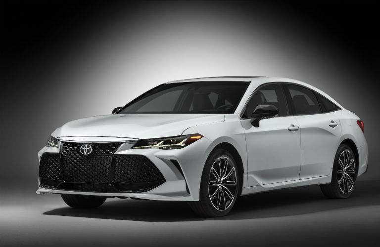 A front left quarter view of a white 2019 Toyota Avalon