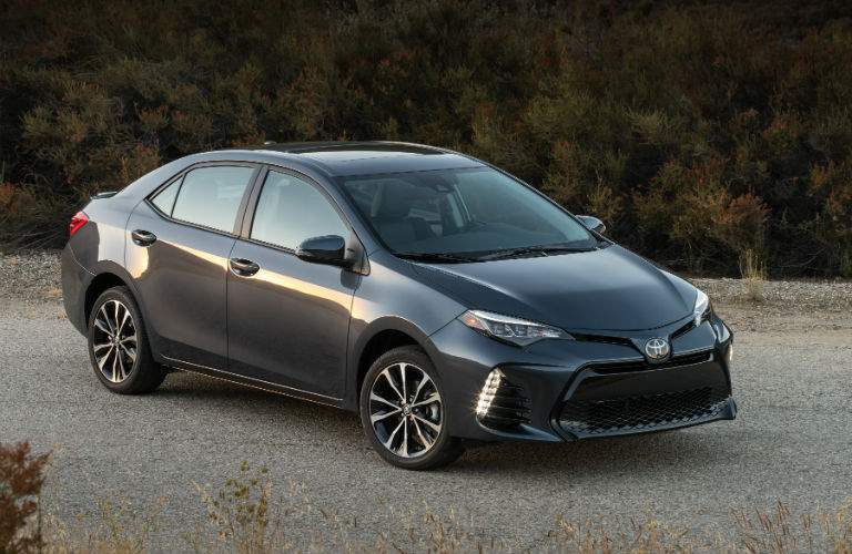 A front right quarter view of a grey 2018 Toyota Corolla in the desert