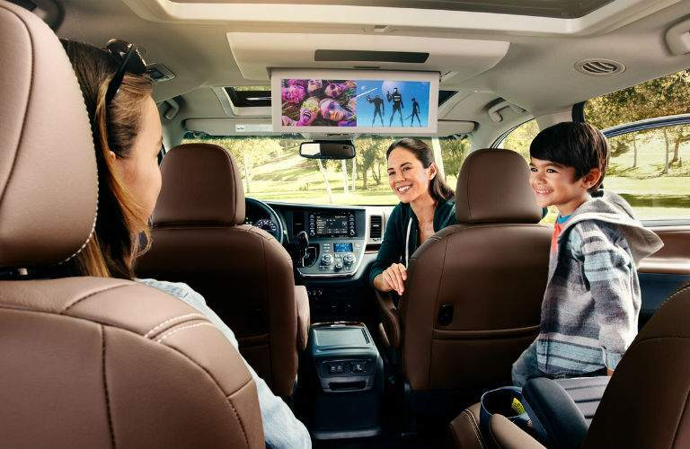 An interior view of a 2018 Toyota Sienna showing how many people can fit comfortably inside of it