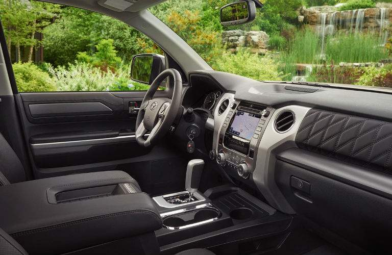 A photo from the passenger side of the 2018 Toyota Tundra showing its interior elements and infotainment system interface