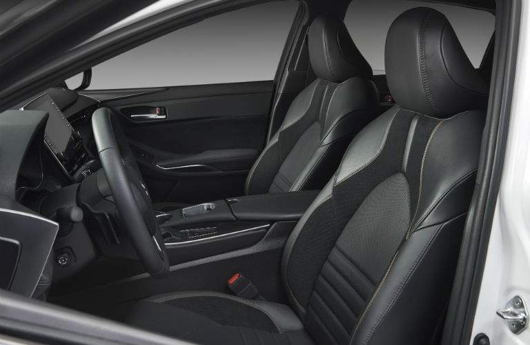 A view looking into the driver's side of the 2019 Avalon showing both front seats