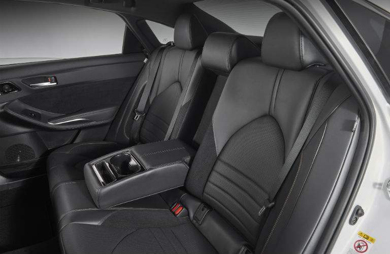 A look at the backseats of the 2019 Avalon showing the center armrest folded down.