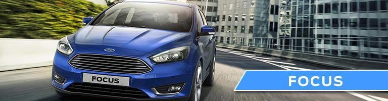 A front view of a blue Ford Focus for sale at Heritage Ford