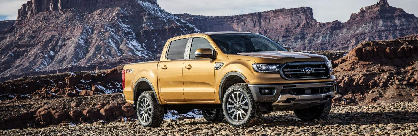 A front right quarter view of the 2019 Ford Ranger in front of some mountains