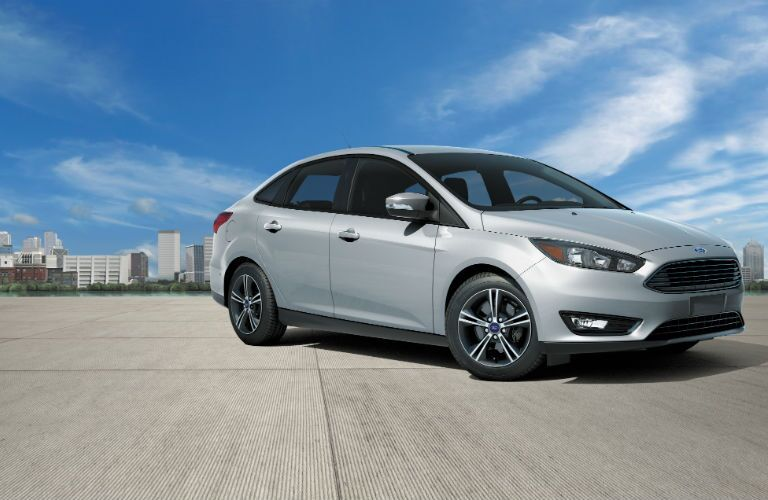 A quarter right profile photo of a grey 2018 Ford Focus