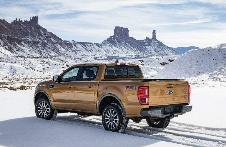 A rear left quarter view of the 2019 Ranger on an off-road trail in the winter