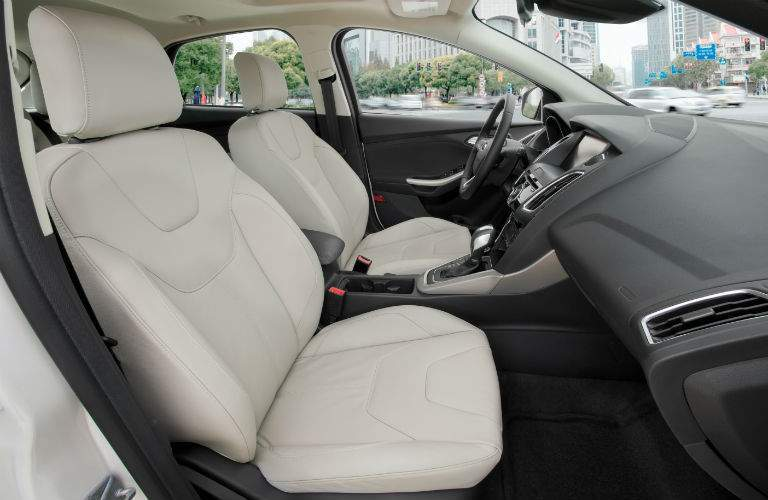 A view of the front of the 2018 Ford Focus from the passenger side with a white interior