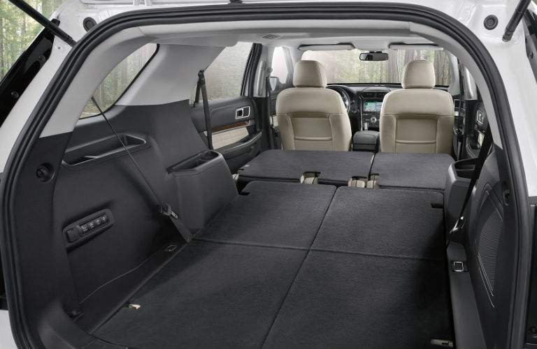 An interior view showing how much cargo space is available in the 2018 Ford Explorer with all of its seats folded down.