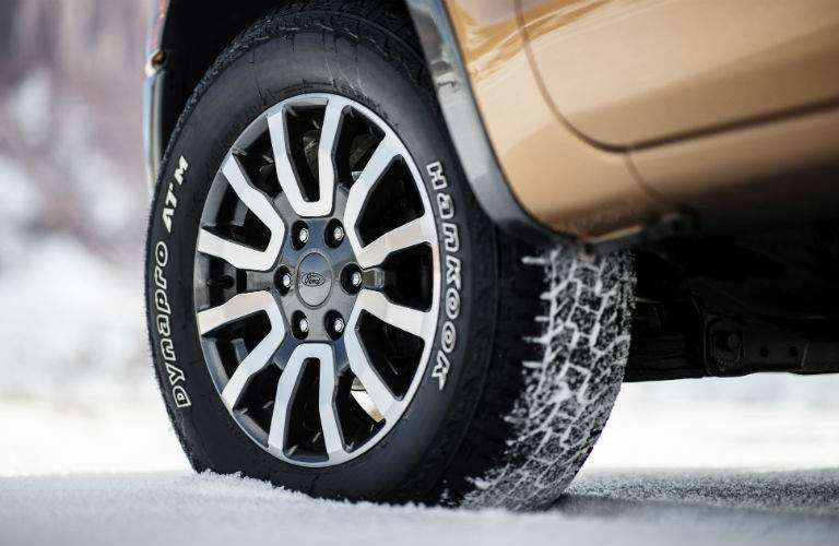 A close up photo of the special off-road tires that come with the FX4 trim of the 2019 Ford Ranger