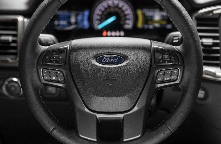 A tight photo of the steering wheel and all of its controls found inside of the 2019 Ranger