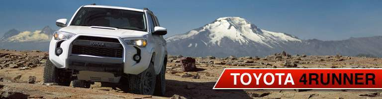 A head-on view of a white Toyota 4Runner on a rocky trail