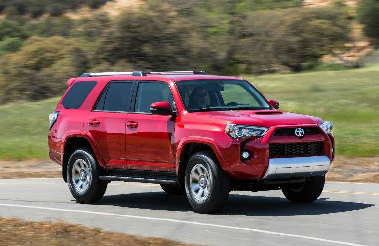 A front right profile view of a red 2018 Toyota 4Runner in motion on the road