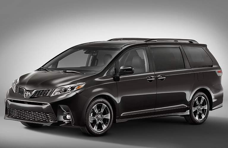 A left profile view of the 2018 Toyota Sienna against a gray background