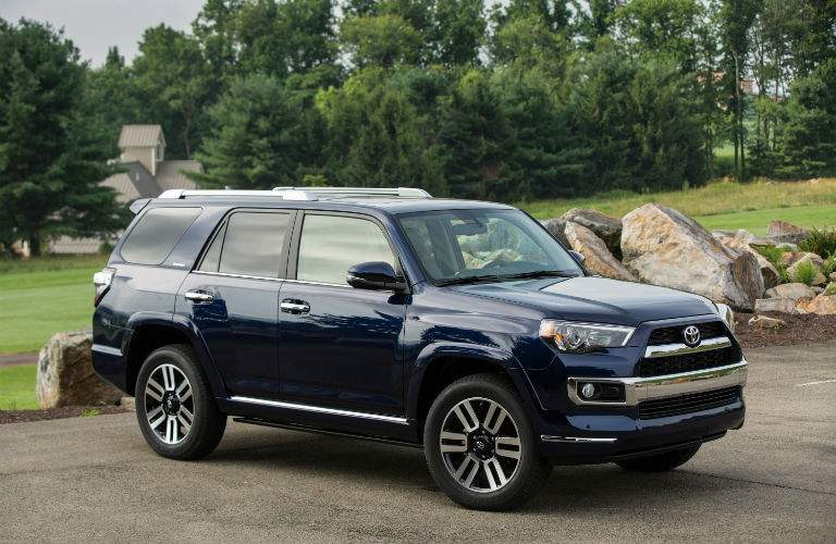 A front right profile view of a blue 2018 Toyota 4Runner in a parking lot