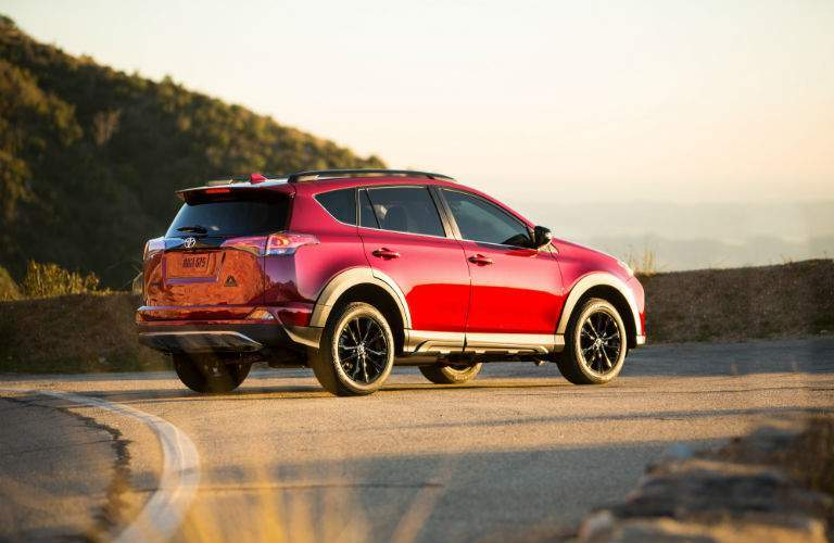 A right profile view of the 2018 Toyota RAV4 Adventure on a mountain road