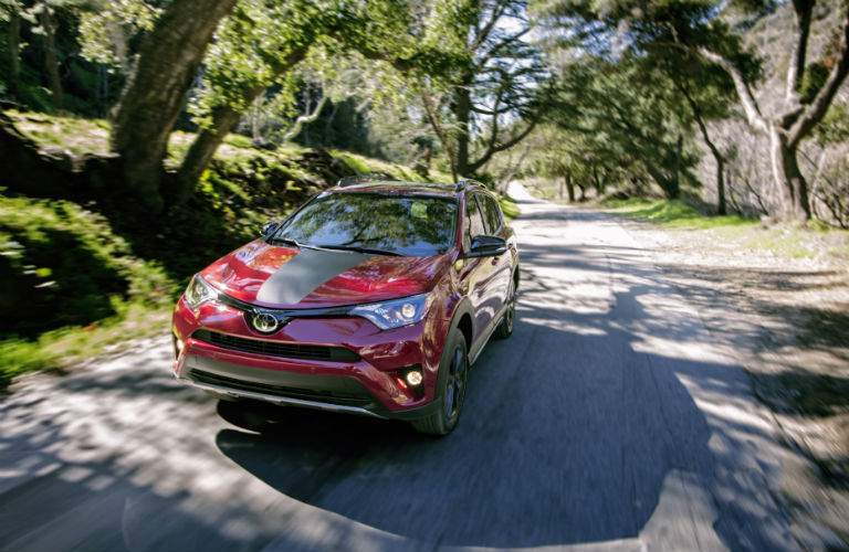 High angle view of a red 2018 Toyota RAV4 Adventure on a road through the woods