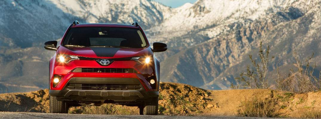 A straight on photo of the 2018 Toyota RAV4 Adventure driving down a mountain road